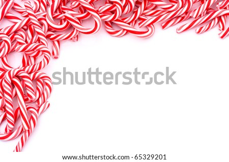 Mini candy canes making a border on a white background, Christmas Candy cane