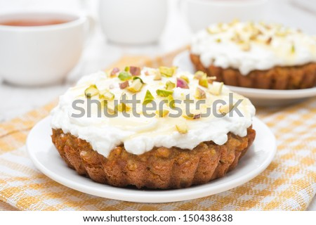 mini carrot cakes with cream of mascarpone and honey close-up, horizontal