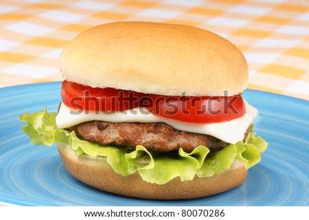 Mini Cheese Burger With Tomato And Salad On A Blue Dish Stock Photo ...