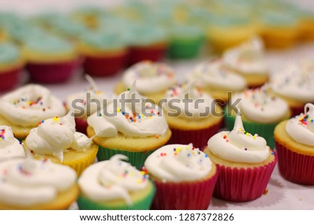 Mini Colorful Birthday Cupcakes In Rows With Frosting And Sprinkles 1287372826
