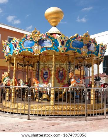 Mini colorful carousel hire for children in funfair Stok fotoğraf ©