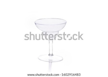 mini cup transparent glass or transparent plastic for drinks, ice cream and sweets on a white background