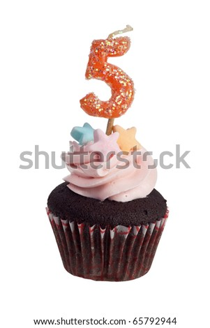 Mini cupcake with birthday candle for five year old isolated on white background