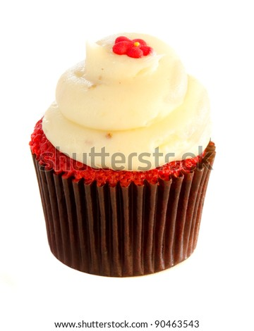 Mini cupcake with cream vanilla frosting isolated on white