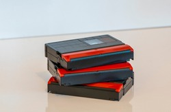 Mini DV tapes, stacked and isolated. Old video recording medium. Obsolote data storage technology from 1990s.