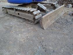 Mini excavator bulldozer tracks, close up.
