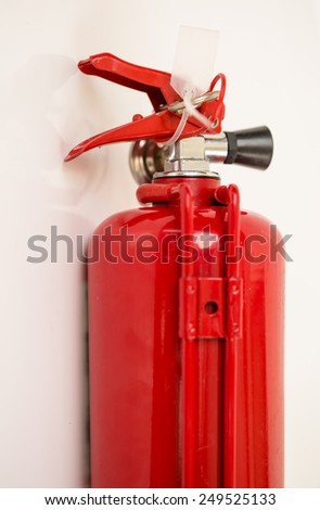Mini Fire extinguisher tank on white background
