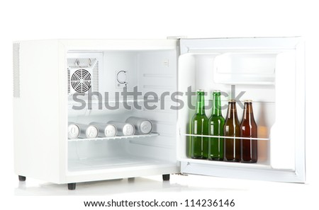 mini fridge full of bottles and cans of beer isolated on white