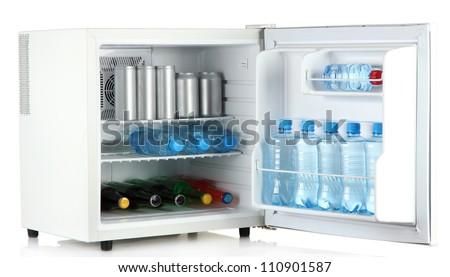 mini fridge full of bottles and jars with various drinks isolated on white