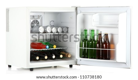 Mini fridge full of bottles of alcoholic beverages isolated on white