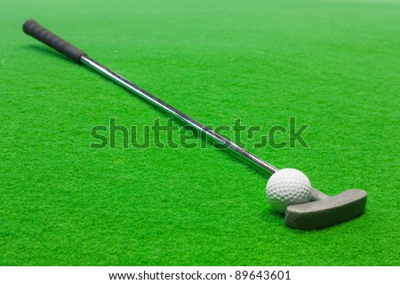 Mini Golf club and ball on the artificial grass