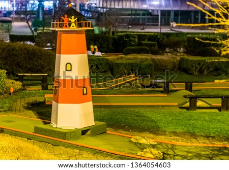 mini golf course with a lighthouse, Recreational sports for adults and kids near the beach #1364054603