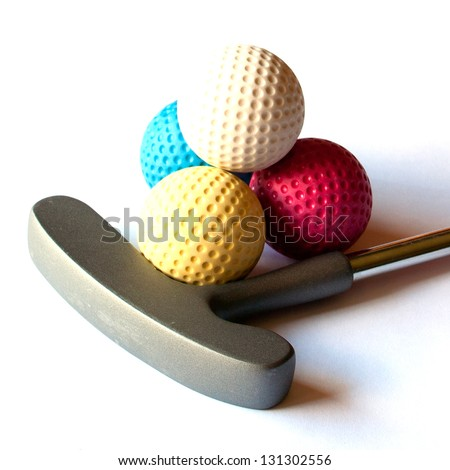 Mini Golf Stick with colored balls on an isolated background