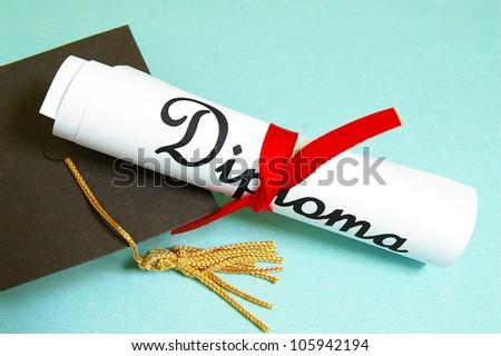 mini graduation cap and diploma