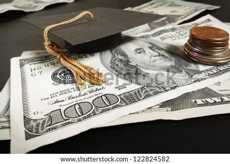 Mini graduation cap mortar board on cash