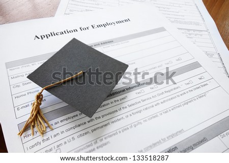 mini graduation cap on a job application form