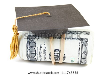 mini graduation cap on rolled up cash