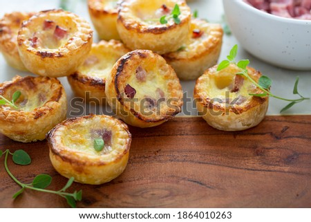 Mini ham and cheese quiches freshly baked on a marble board ready to eat ストックフォト ©