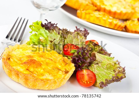 Mini leek quiche served with salad