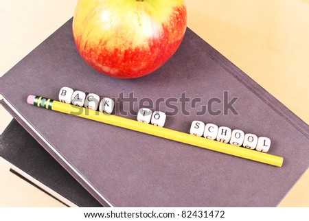 Mini Letters Spelling Out Back To School on Books