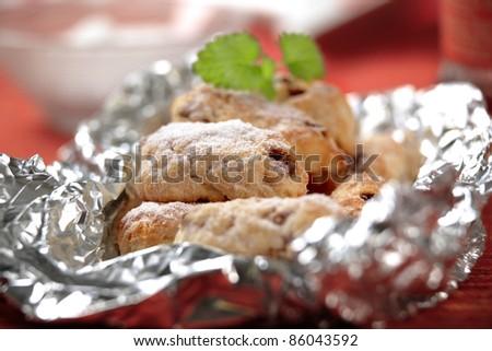 Mini marzipan stollen cakes in aluminum foil