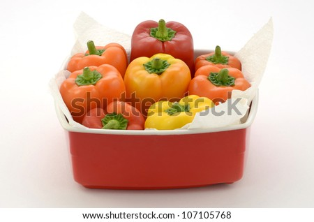 Mini peppers in red tin