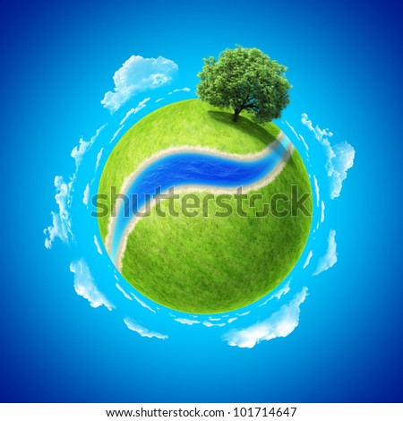 Mini planet concept. Empty space and river on fresh green field and sole standing dense tree. Place for your text, product or logo. Earth collection.