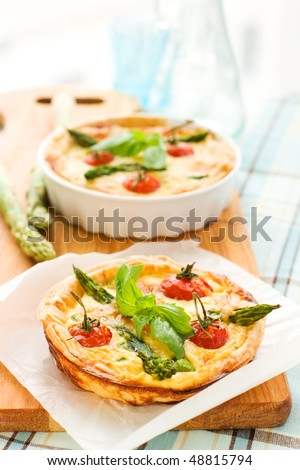 mini quiche with tomato cherry and green asparagus