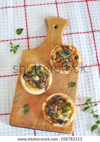 Mini quiches with mushrooms - stock photo