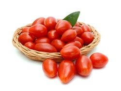 Mini red tomatoes isolated in basket on white