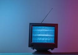 Mini Retro tv antenna receiver. Old fashioned TV set. Pink blue gradient neon light. Television noise, no signal. 80s retro wave
