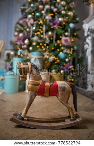 mini rocking horse wood chair on Christmas background
