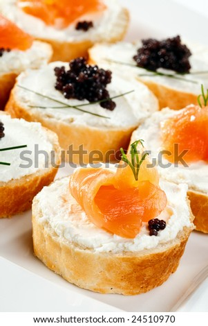 Mini sandwiches - bagel, smoked salmon, caviar and cream cheese