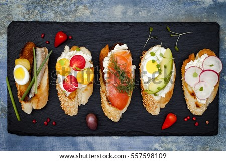 Shutterstock Mini sandwiches food set. Brushetta or authentic traditional spanish tapas for lunch table. Delicious snack, appetizer, antipasti on party or picnic time. Top view.