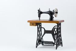 Mini sewing machine on white background