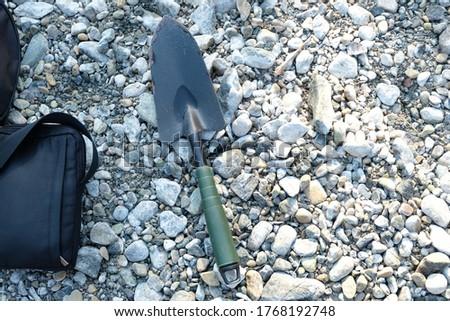 Mini shovel closeup on pebbles Stok fotoğraf ©