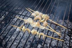 mini skewers of bacon and garlic on wooden skewers