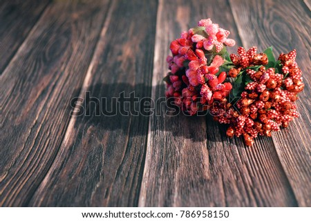 Mini Stamens. Artificial stamen with leaves on a wooden background. #786958150