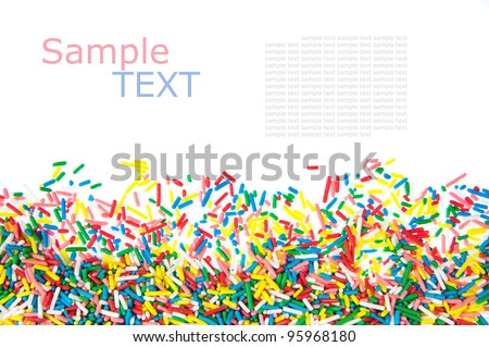 Mini sweet sprinkles  making a border isolated on white background  with sample text
