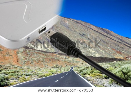 mini usb cable cord and external hard drive over a landscape with a road