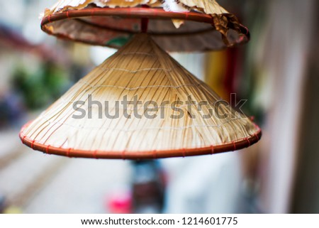 Mini vietnamese Conical hat hanging on the street