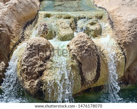 Mini waterfall over colorful stones, similar to a stream of flowing water #1476178070