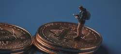 miniature adventurer man observing a map on a pile of bitcoins, depicting the adventurous and risky nature of investing in this virtual currency, in a panoramic format to use as web banner or header