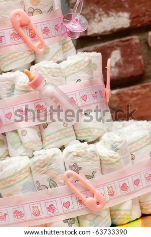 Miniature Baby Bottle on Stacked Diapers ( Baby Shower )