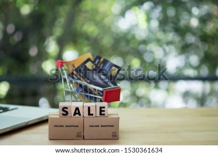 Miniature brown box with wooden block SALE. Consumers can buy products directly from a seller over internet using web browser. Ideas about online shopping and e-commerce.