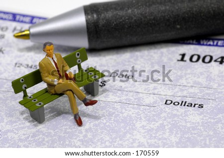 Miniature Businessman Sitting on a Check.  See Portfolio For Similar Concepts
