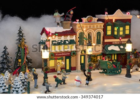 miniature christmas village scene with houses trees people dogs and cats celebrating the - Miniature Christmas Town Decorations