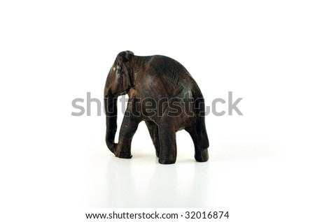 Miniature elephant made of wood on white background.