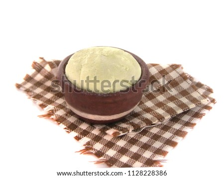 Miniature fake bowl with raw dough on checkered towel. Dollhouse miniature, polymer clay toy, plastic dummies. Photo of yeast dough for bakery products, bread and cooking.