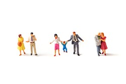 miniature family with father,mother ,son isolated on white background .Image for property real estate investment concept or happy family  concept.
